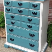 "Maple chest of drawers in distressed Sea Blue and Off White with Black Glaze. Original pulls painted black. 46.5"" tall, 36"" wide, 19"" deep."