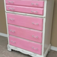 Chest of Drawers in distressed Pink & Off White with Black Glaze. New crystal pulls. From Facelift Furniture's Chests of Drawers collection.