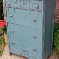 """Distressed Sea Blue art deco dresser with Black Glaze. Four drawers with new brushed metal pulls. 45"""" tall, 30"""" wide, 17"""" deep."""
