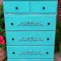 Vintage chest of drawers with ornate appliques added to drawers. Four deep drawers with new knobs. From Facelift Furniture's Chests of Drawers collection.
