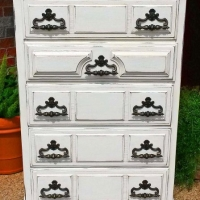 Vintage chunky chest of drawers in distressed off white with tobacco glaze. Five spacious drawers with original pulls. From Facelift Furniture's Chests of Drawers collection.