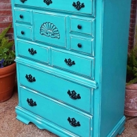 Chest of Drawers in distressed Turquoise and Black Glaze. Five drawers with original pulls painted black. From Facelift Furniture's Chests of Drawers collection. purchase.
