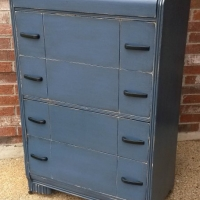 Waterfall chest in Distressed Deep Blue with Black Glaze. Four spacious drawers. Original pulls painted black. From Facelift Furniture's Chests of Drawers collection.
