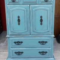 Armoire Chest in distressed Sea Blue with Black Glaze. Original pulls painted black. 3 drawers inside doors. From Facelift Furniture's Chests of Drawers collection.