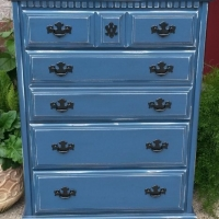 Chest of drawers in Denim Blue with Black Glaze. Distressing reveals white primer and original wood tones. Original pulls painted black. From Facelift Furniture's Chests of Drawers collection.