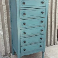 Narrow Chest of Drawers in distressed Sea Blue with Black Glaze. New knobs. . From Facelift Furniture's Chests of Drawers collection.