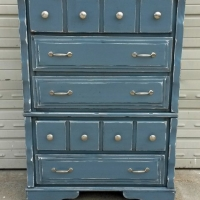 Chest of Drawers in Slate Blue with Black Glaze, distressed down to white primer.  New brushed silver pulls. From Facelift Furniture's Chests of Drawers collection.