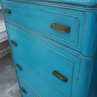 Waterfall Chest of Drawers in distressed Peacock Blue with Black Glaze. Original vintage pulls. From Facelift Furniture's Chests of Drawers collection.