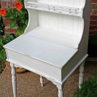Distressed antiqued white writing desk with hutch. Compact, and ideal for an entry piece. Top opens to storage compartment. From Facelift Furniture's Desk & Vanities collection.