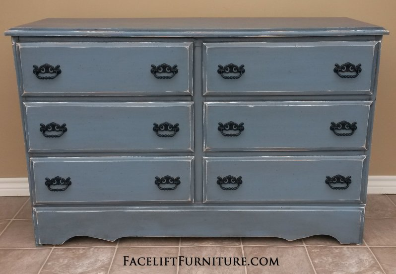 """Dresser in Slate Blue with Black Glaze, distressed down to white primer.  Original pulls painted black.  48"""" long, 17"""" deep, 31"""" tall."""