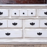 "Dresser in Off White with Tobacco Glaze. Distressing reveals white primer and original wood tones. Seven drawers with original pulls painted dark bronze. 62"" long, 34"" tall, 18"" deep. From Facelift Furniture's Dressers collection."