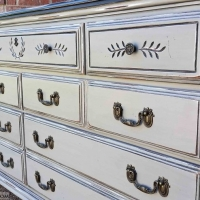 "Dresser in distressed black and aspen gray with black glaze. Seven drawers with original pulls. 68"" long, 18"" deep, 34"" tall. From Facelift Furniture's Dressers collection."