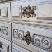 """Dresser in distressed Aspen Gray with Black Glaze. Nine drawers with original pulls. 64"""" long, 30"""" tall, 18"""" deep. From Facelift Furniture's Dressers collection."""