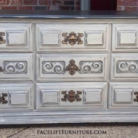 "Dresser in distressed Aspen Gray with Black Glaze. Nine drawers with original pulls. 64"" long, 30"" tall, 18"" deep. From Facelift Furniture's Dressers collection."