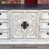 """Vintage dresser in distressed off white with tobacco glaze. Top painted dark brown. 9 drawers total, with 3 behind large center door. Original pulls. 72"""" long, 20"""" deep, 31"""" tall. From Facelift Furniture's Dressers collection."""