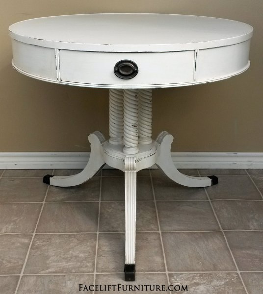 Large Duncan Phyfe Pedestal Table in lightly distressed Antiqued White with light Tobacco Glaze. One drawer. From Facelift Furniture's End Tables collection.
