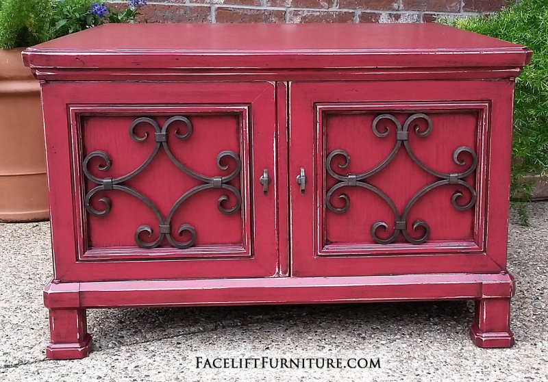 Vintage coffee table in Barn Red with Black Glaze. Distressing reveals primer and original wood tones. From Facelift Furniture's End Tables collection.