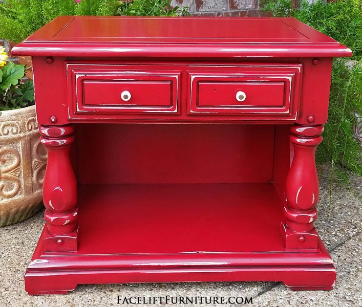 Chunky end table in Barn Red with Black Glaze accenting detail. Distressing reveals white primer and original wood tones. From Facelift Furniture's End Tables collection.