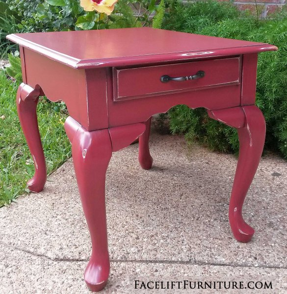Queen Anne End Table in Barn Red with Black Glaze. Distressing reveals white primer and original woods tones. New drawer pull. From Facelift Furniture's End Tables collection.