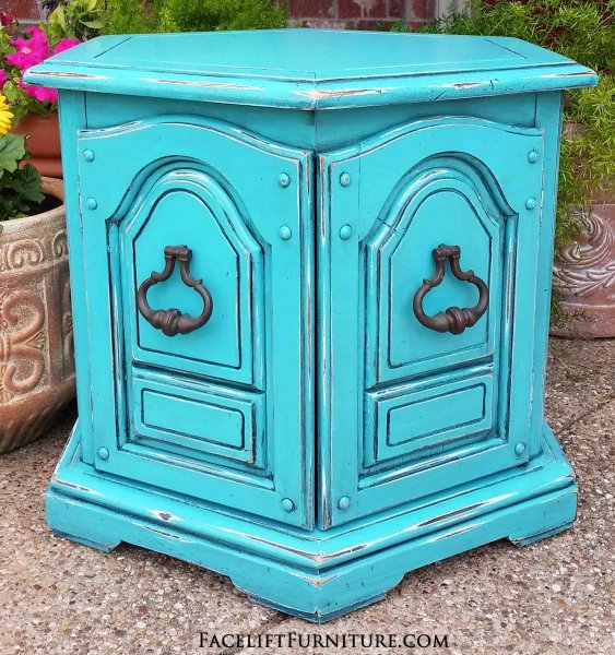 Vintage hexagon end table in distressed Turquoise with Black Glaze accenting the detail. Distressing reveals white primer and original wood tones. From Facelift Furniture's End Tables collection.
