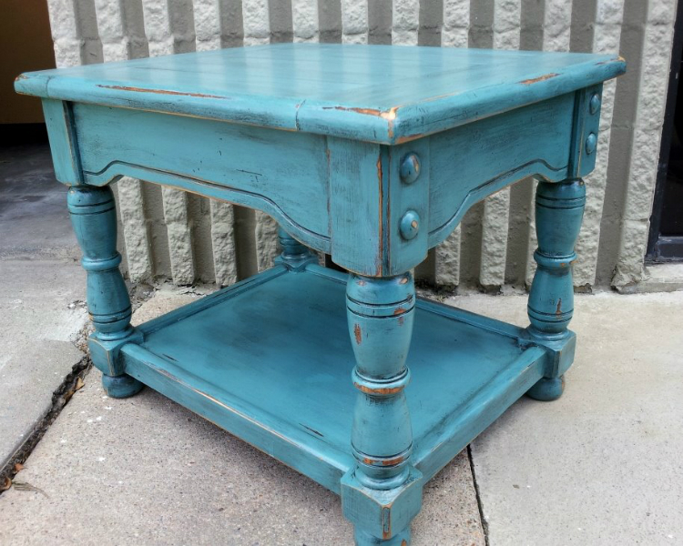Chunky end table upstyled in distressed Sea Blue and Black Glaze.   From Facelift Furniture's End Tables collection.