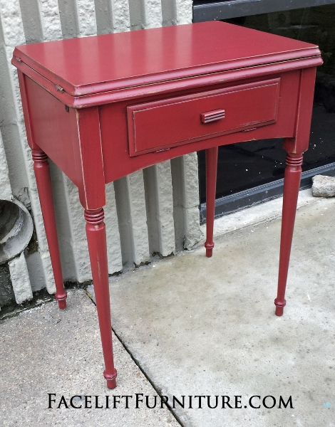 Antique Sewing Table in distressed Barn Red with Black Glaze.  From Facelift Furniture's End Tables collection.
