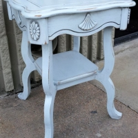 Ornate End Table custom painted distressed Light Blue (provided by customer), with Black Glaze accenting detailed areas. From Facelift Furniture's End Tables collection.
