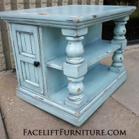Chunky End Table distressed Robin's Egg Blue with Black Glaze. Shelves and storage area behind double doors. From Facelift Furniture's End Tables collection.