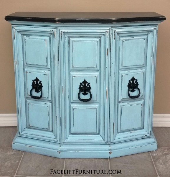 Wall Console in distressed Robin's Egg Blue with Black Glaze. Top and original pulls painted black.