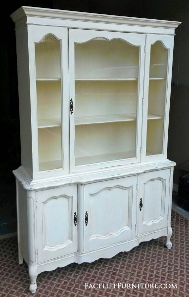"French Hutch in distressed Off White with Tobacco Glaze. Stationary upper shelves with bottom storage shelf also. Compact in size at 68"" tall, 46"" wide, 18"" deep."