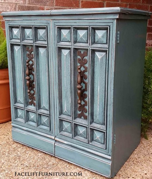 Vintage sewing cabinet in distressed Sea Blue with Black Glaze. Repurpose as a tall end or occasional table. Refinished on all 4 sides. Original chunky pulls, with storage area within. From Facelift Furniture's Hutches, Cabinets & Buffets collection.