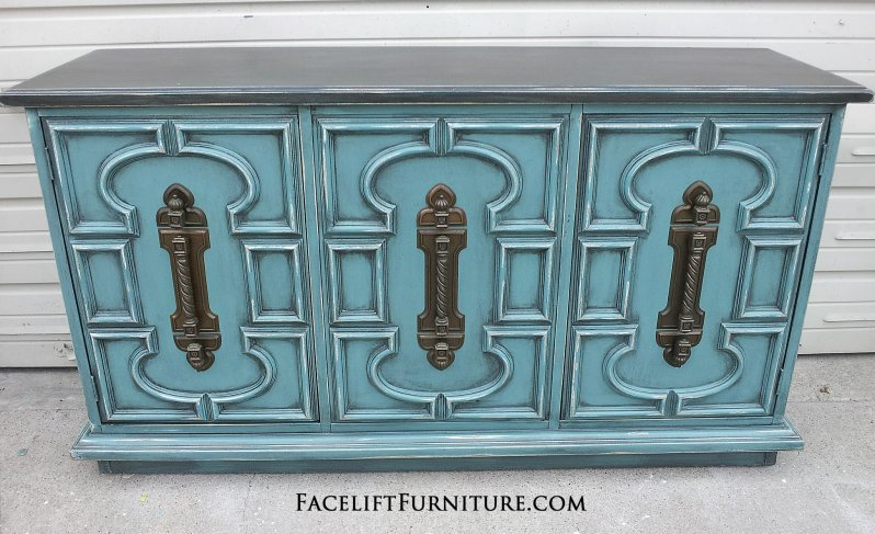 Sea Blue Vintage Cabinet with Black Glaze. Distressing reveals heavy white primer. Original pulls.