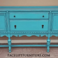 "Antique Buffet custom refinished in Lowe's Valspar ""Blue Jewel"". Lightly distressed, with Black Glaze accenting detailed areas. From Facelift Furniture's Hutches, Cabinets & Buffets collection."