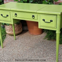 Vanity desk in distressed Lime Green with Black Glaze. Two side drawers, with top opening over middle compartment. Original pulls painted black. From Facelift Furniture's Lime Green Furniture collection.