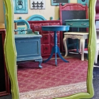 Curvy Lime Green Mirror, with Black Glaze and distressing revealing white primer and original wood tones. From Facelift Furniture's Mirrors Collection.