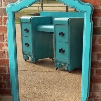 Curvy mirror in distressed Turquoise with Black Glaze. From Facelift Furniture's Mirrors Collection.