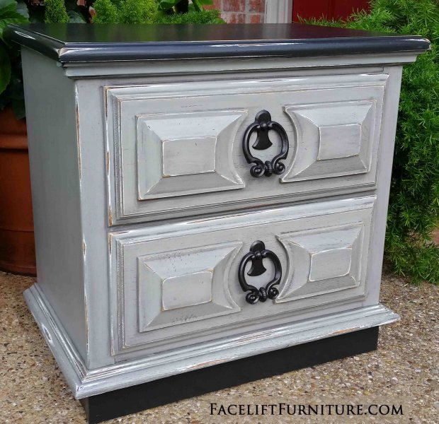 Nightstand in distressed Black and Aspen Gray, with Black Glaze accenting detailed areas. Distressing reveals white primer and wood tones. Original pulls painted dark bronze. A great option for an office printer stand!