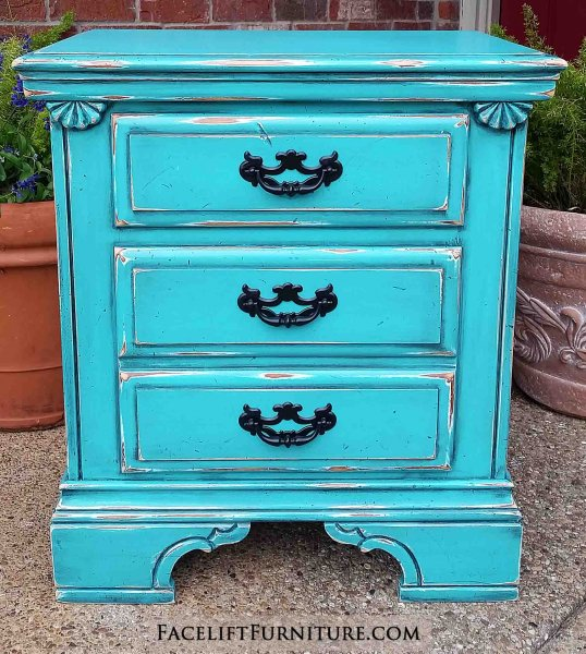 Nightstand in distressed Turquoise and Black Glaze. Two drawers with vintage pulls painted black. From Facelift Furniture's Nightstands collection.