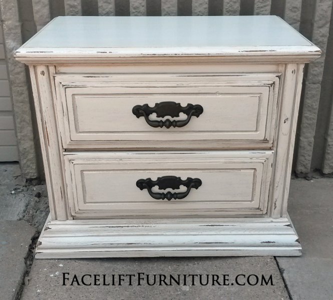 Nightstand in distressed Antiqued White and Tobacco Glaze, with hardware painted dark bronze. From Facelift Furniture's Nightstands collection.
