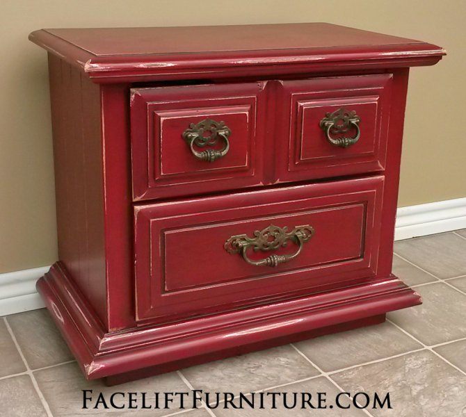 Nightstand in Chili Pepper Red and Black Glaze, with distressing revealing white primer. Lots of character and pop with this piece! From Facelift Furniture's Nightstands collection.
