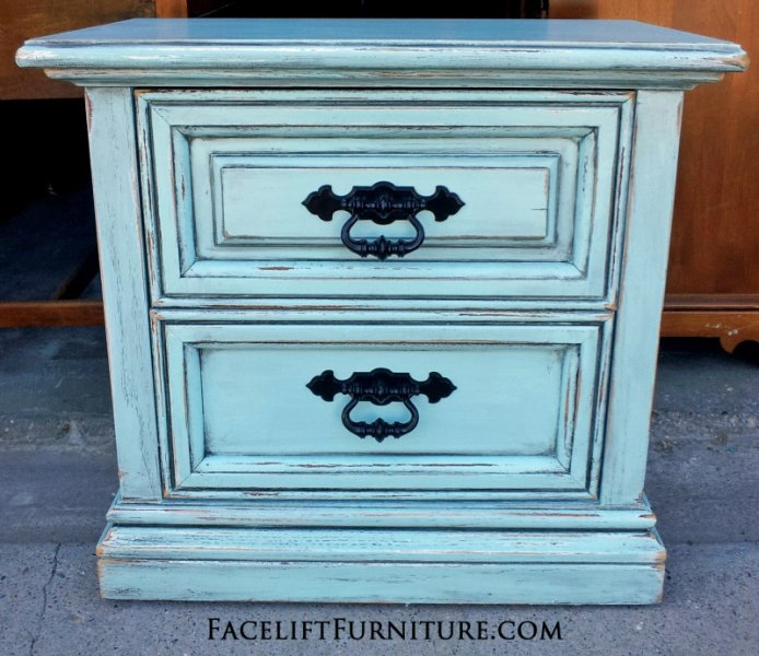 Nightstand in distressed Robin's Egg Blue with Black Glaze. Original pulls painted black. From Facelift Furniture's Nightstands collection.