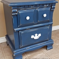 Nightstand in distressed Denim Blue with Black Glaze. Distressed down to white primer and wood tones. Pulls painted white.