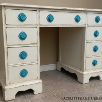 Antique Desk in distressed Off White with Tobacco Glaze. Seven drawers with original vintage pulls painted Turquoise!