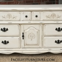 Dresser is distressed Off White with Tobacco Glaze. Two drawers behind drawer. Pulls painted dark bronze.