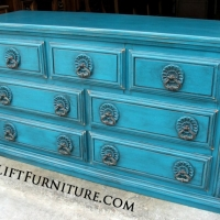 Ornate Dresser in distressed Peacock Blue with Black Glaze. Original pulls. From Facelift Furniture's Dressers collection.