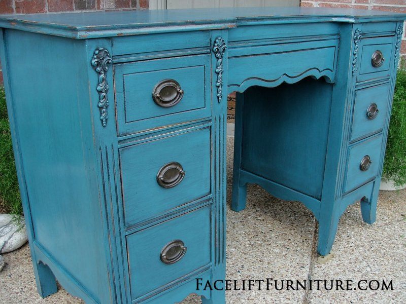 Vanity Desk in distressed Peacock Blue with Black Glaze. Original pulls.  From Facelift Furniture's DIY Inspiration album.