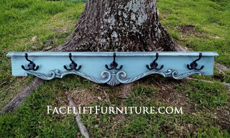 Ornate turquoise coat rack re-purposed from side of coffee table.  In distressed Sea Blue with Black Glaze ~ Facelift Furniture ~