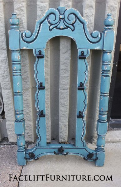 Ornate Chair back in distressed Sea Blue with Black Glaze, with black coat hooks and bull dog clips painted black. From Facelift Furniture's Repurposed Wall Pieces collection.