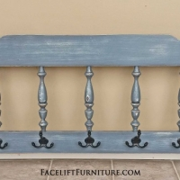 Twin maple headboard repurposed into coat rack. In Slate Blue with Black Glaze. Distressing reveals white primer.