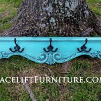 Ornate turquoise coat rack re-purposed from side of coffee table.  In distressed Turquoise with Black Glaze ~ Facelift Furniture ~